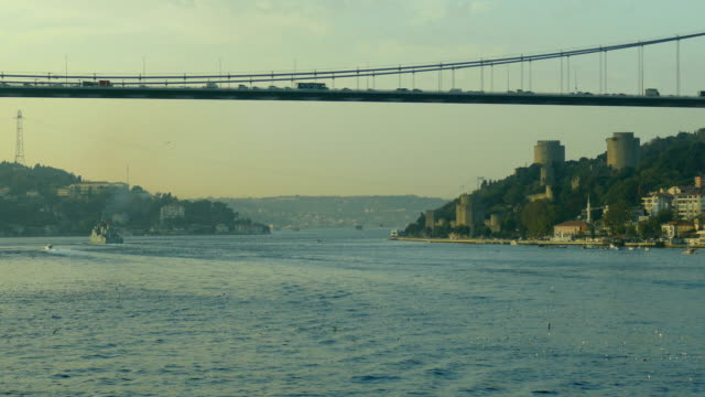 military ship in the Bosphorus Strait against the background of famous places of Istanbul video