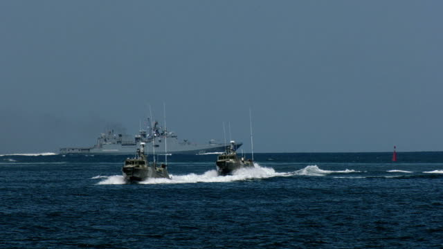 military ships and boats of special forces at sea during exercises