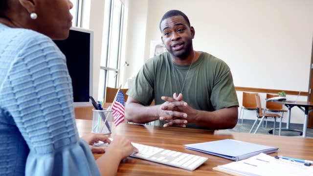 Military soldier talks about a loan with a bank officer
