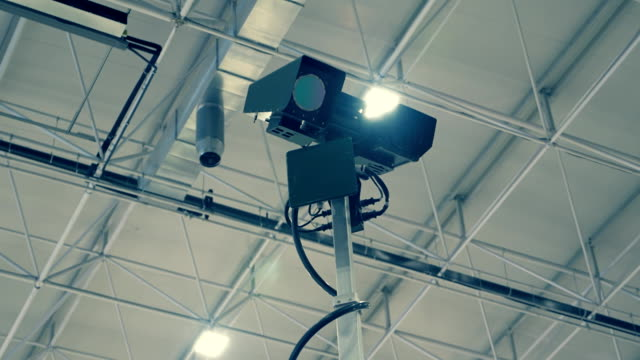 Military special video surveillance camera on a high telescopic pole in hangar video