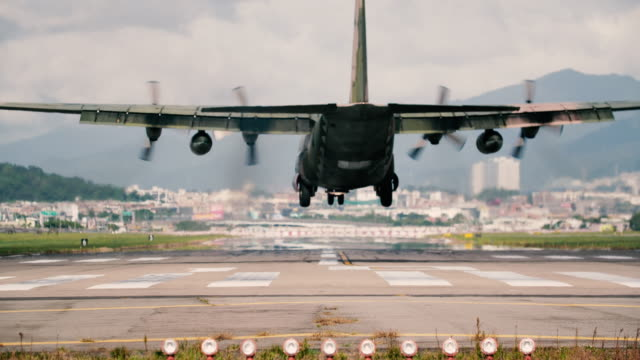 Military transport flying over head