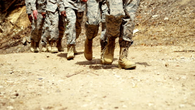 Military troops walking at boot camp 4k