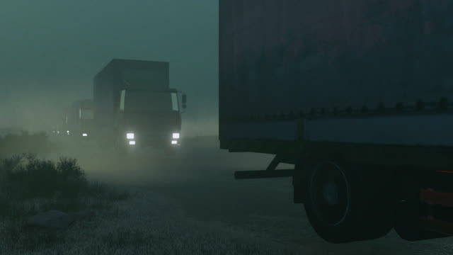 military trucks convoy on a dirt road at night - caravan stock videos & royalty-free footage