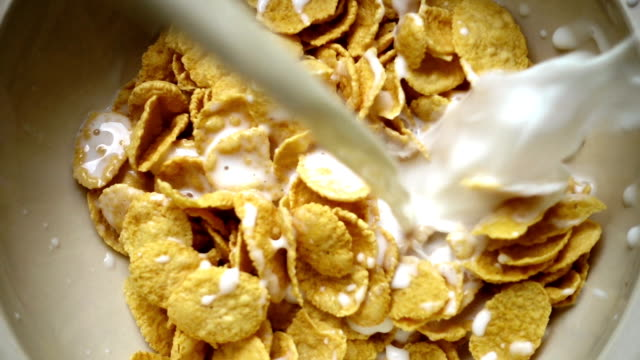 SLO MO - Milk Being Poured onto the Breakfast Cereal