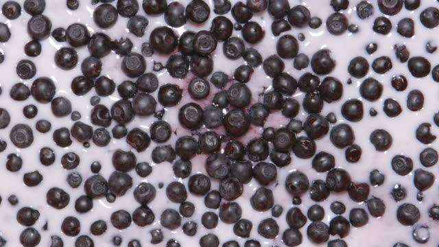 TOP VIEW: Milk fills a bilberries video
