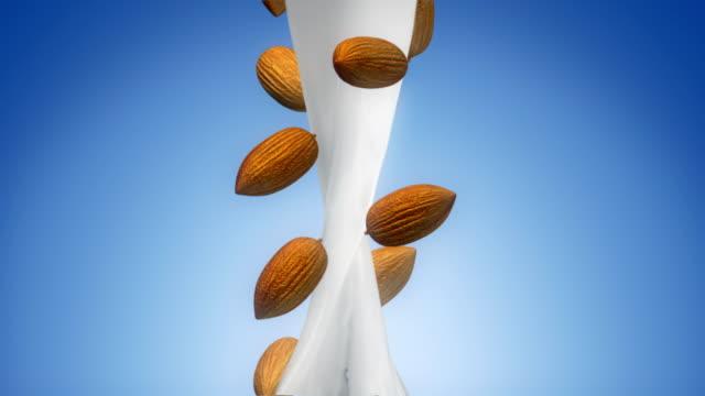 vídeos de stock e filmes b-roll de milk flow with almond - amendoas