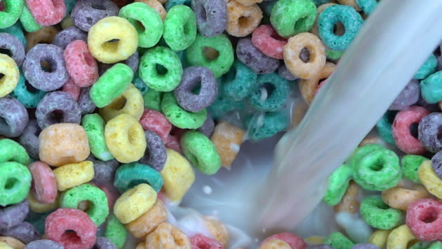 Milk Pour Into Dry Fruit Flavored Cereal In Slow Motion video