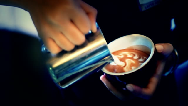 Milk pouring by a Barista. video