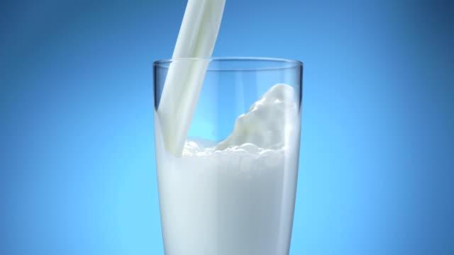 milk pouring into glass, slow motion - süt stok videoları ve detay görüntü çekimi