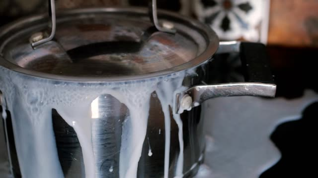 milk, soup is boiling over, flowing out of the pot milk, soup is boiling over, flowing out of the pot cooking pan stock videos & royalty-free footage