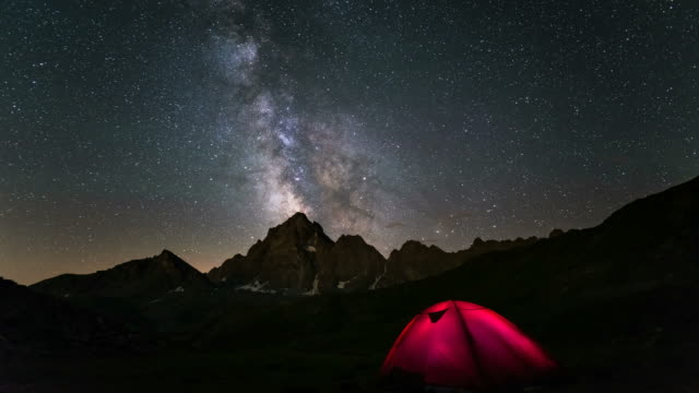 Milky Way Time Lapse with camping tent on the Alps video