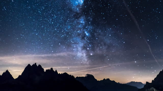 milky way with mountain background timelapse - milky way stock videos and b-roll footage