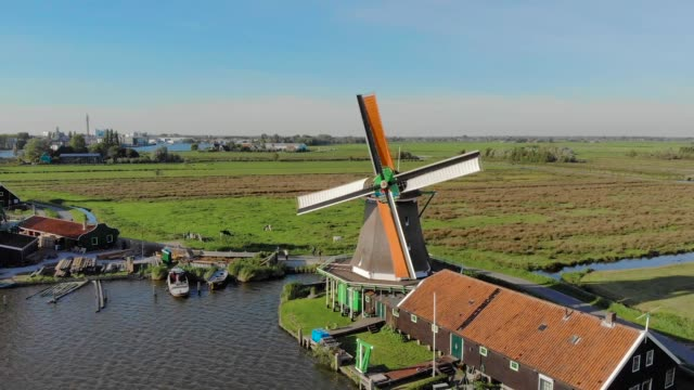 Mill in Netherlands aerial view forward move