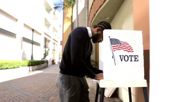 Millenial Black Man Voting in Election