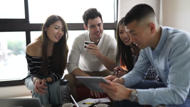 Millennials working together in the living room video