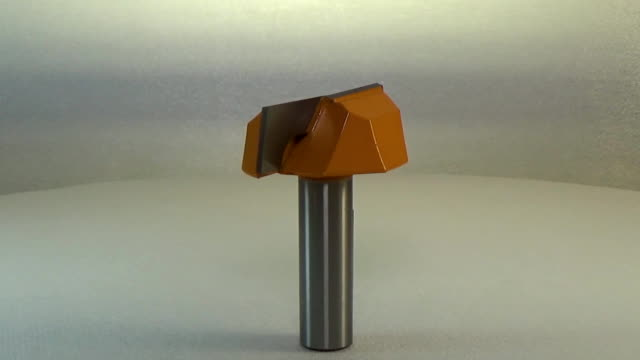 Milling cutter and router bit. Orange tools, big long blade cleaning bottom bit video