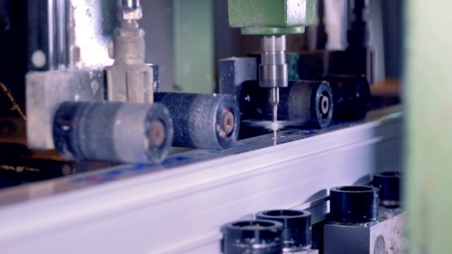 Milling industrial machine produces plastic part at a factory. video