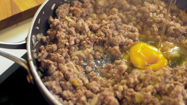 Mince meat in a pan for bolognese sauce Mince meat in a pan for bolognese sauce ground beef stock videos & royalty-free footage