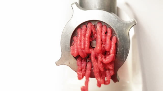 Mincer machine in action with fresh chopped meat video