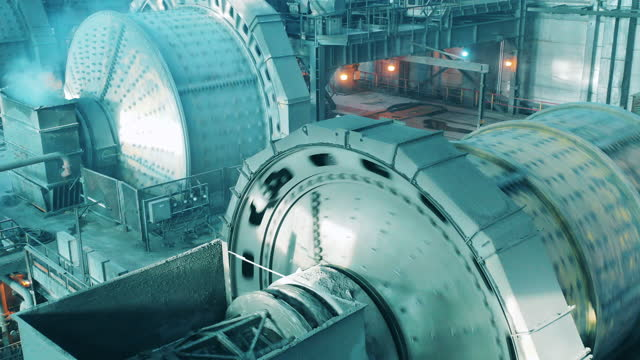 Mineral grinding mills are rotating while working video