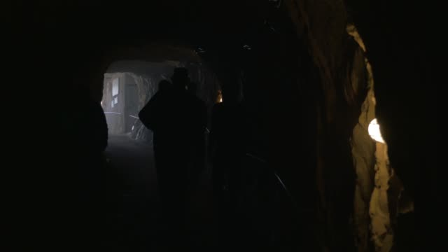 mineworkers leaving the tunnel - sottosuolo video stock e b–roll