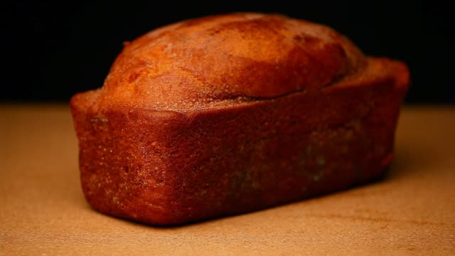 mini cake wooden table hd footage - panettone video stock e b–roll