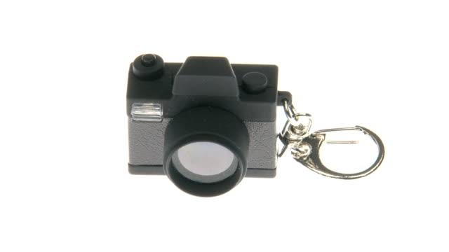 mini telecamera fare una foto - portachiavi video stock e b–roll