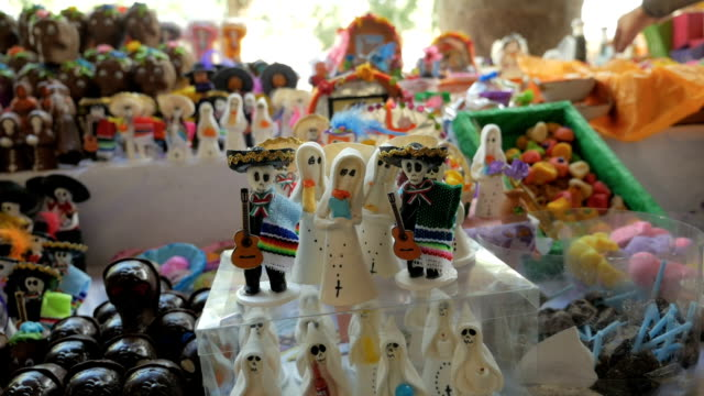Miniature candy ghosts and skeletons on display for Day of the Dead video