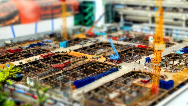 miniature construction site, tilt shift effect time lapse miniature construction site, tilt shift effect foundation make up stock videos & royalty-free footage