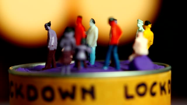 Miniature dolls with lockdown word and bokeh background