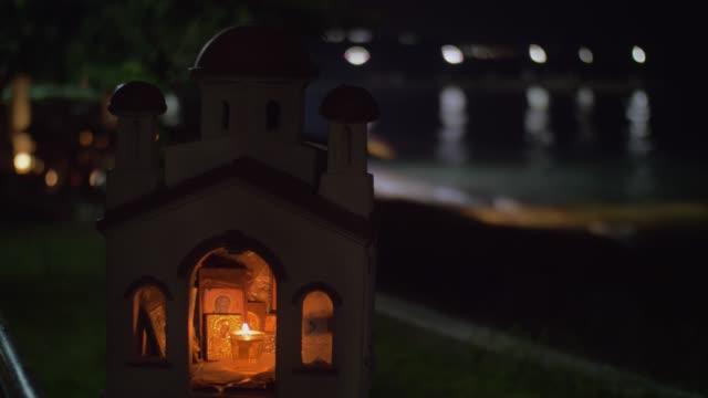 Miniature of Greek Orthodox church on sea-front at night video