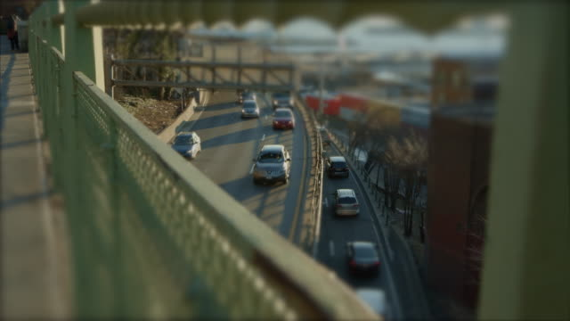Miniature traffic at sunset with cars and trucks video