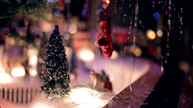 Miniature Train under Xmas Tree at Night video