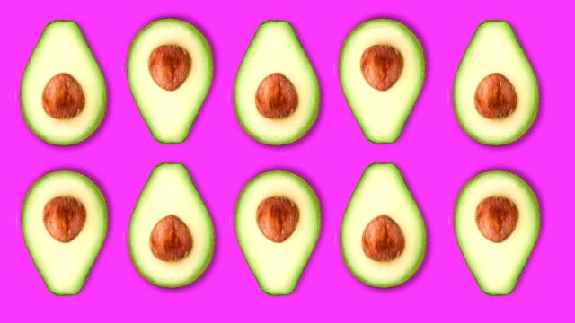 minimal motion art, avocado on the rose - sesamo video stock e b–roll