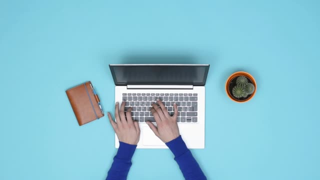 Minimalist desktop and woman working with a laptop