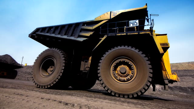 Mining dump truck Mining dump trucks in the open pit mine large stock videos & royalty-free footage