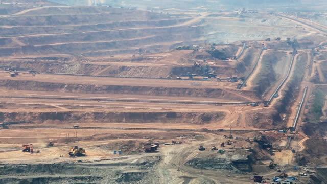 Mining dump trucks working in Lignite coalmine lampang thailand video