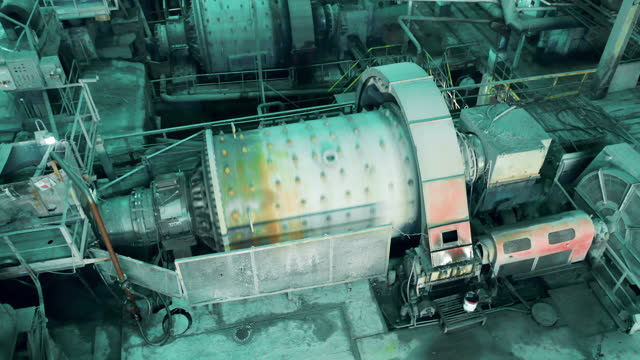 Mining factory premises with grinding machinery at work video
