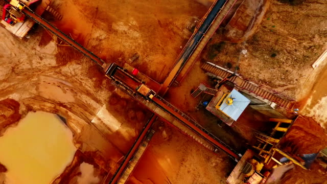 Mining industry. Process of sorting sand on mining conveyor belt. Mining industry. Process of sorting sand on mining conveyor belt. Sand moving on automated conveyor belt at sand quarry. Aerial view of mining equipment working at sand mine. Mining machinery crane construction machinery stock videos & royalty-free footage