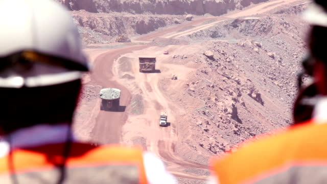 Mining Industry Workers watch activity in a copper mine mining natural resources stock videos & royalty-free footage