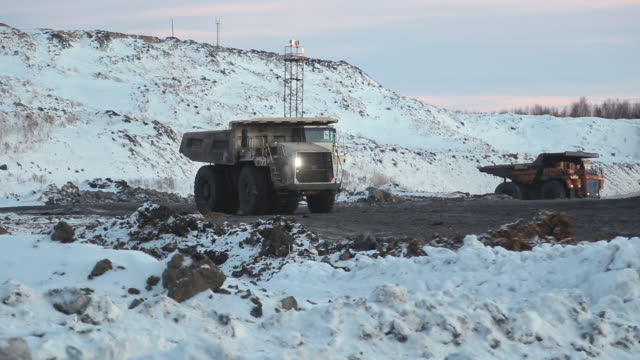 A mining truck is carrying coal A mining truck is carrying coal. Open pit coal mining in winter construction equipment stock videos & royalty-free footage