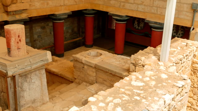 Minoan Palace of Knossos, Heraklion, Crete, Greece Slow panning shot of a temple within the complex of the Minoan Palace of Knossos, Heraklion, Crete, Greece palace stock videos & royalty-free footage