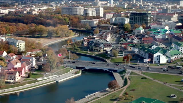 minsk aerial shot. city centre old town. svisloch river. island of tears. - беларусь стоковые видео и кадры b-roll