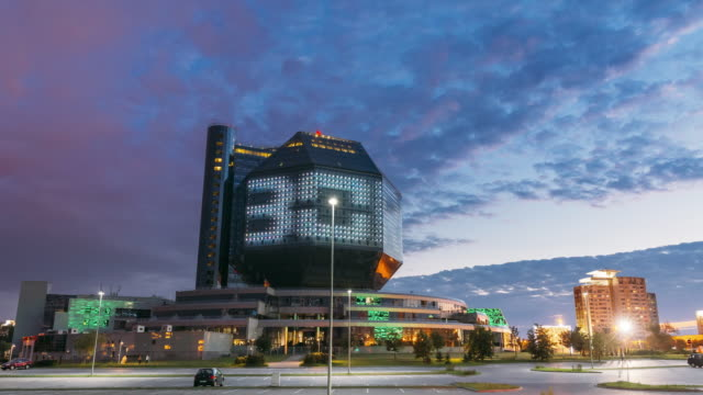 minsk, belarus. national library building in summer evening sunset time. evening night scenic view of famous landmark. hyperlapse, motion time lapse time-lapse day to night transition - białoruś filmów i materiałów b-roll