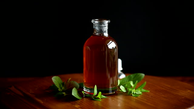 mint syrup in a glass bottle - decanter video stock e b–roll