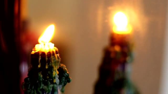 mirror reflection of burning candle video