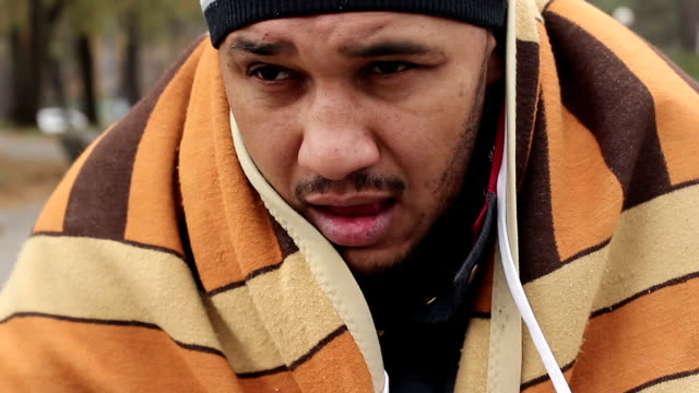 Miserable face of homeless male looking with hope at camera, begging. Poverty video