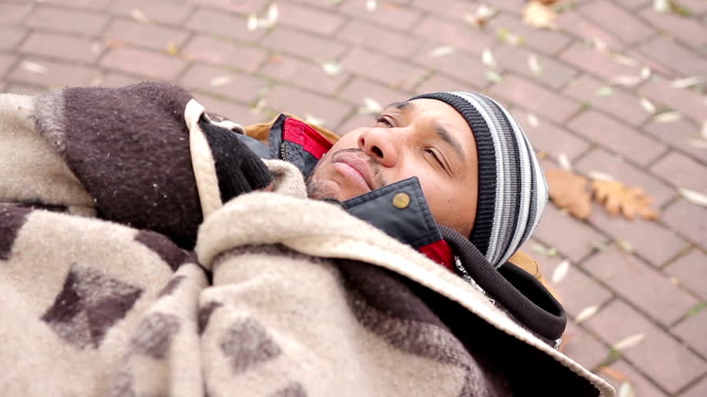 Miserable face of homeless man sleeping on bench, feeling cold and unhappy video