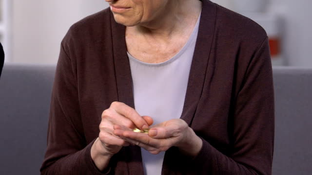 Miserable old woman holding coins, rich senior man counting dollars, social gap