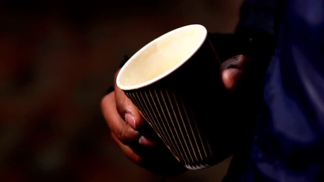 Miserable poor man begging for charity donation with paper cup video